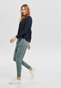 ONLY - Tracksuit bottoms - balsam green - 1
