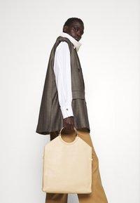 HUGO - HULANA - Kalhoty - light/pastel brown - 3