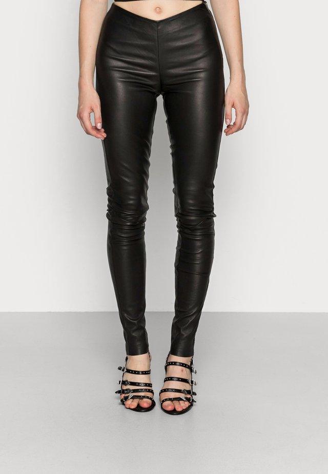 YASZEBA STRETCH - Leather trousers - black