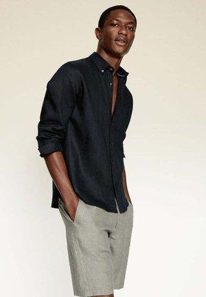 SLIM FIT - Camisa - schwarz