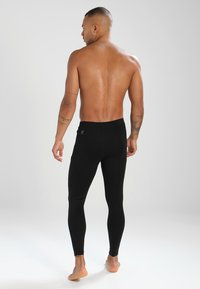 Puma - LIGA BASELAYER LONG TIGHT - Base layer - black - 2