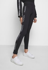 HUGO - NEFLECTIVE - Leggings - Hosen - black - 0