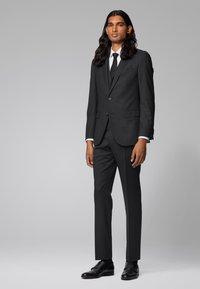 BOSS - GENIUS5 - Suit trousers - black - 1