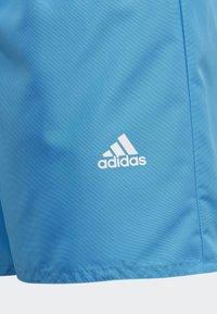 adidas Performance - BADGE OF SPORT PRIMEGREEN REGULAR SWIM SHORTS - Swimming shorts - blue - 3