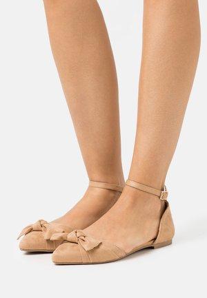 Ankle strap ballet pumps - beige