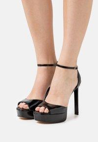 Guess - ALDEN - Platform sandals - black - 0