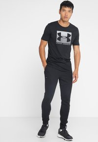 Under Armour - RIVAL  JOGGER - Tracksuit bottoms - black - 1
