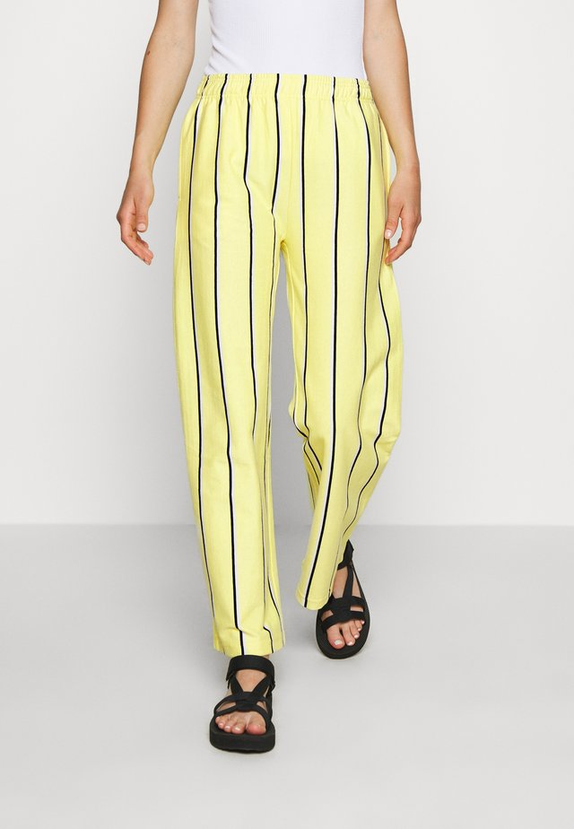RONNY PANTS - Tracksuit bottoms - lemon multi