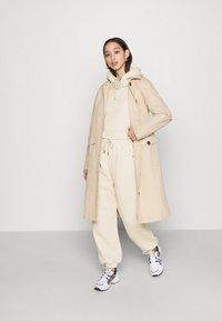 U Collection by Forever Unique - Spodnie treningowe - beige - 1