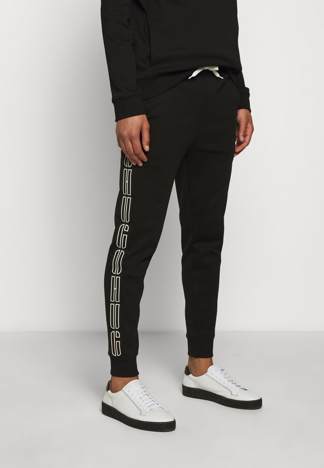 DAKY - Trainingsbroek - black