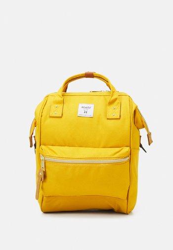 CROSS BOTTLE UNISEX - Zaino - mustard yellow