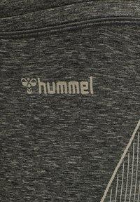 Hummel - Tracksuit bottoms - vetiver melange - 4