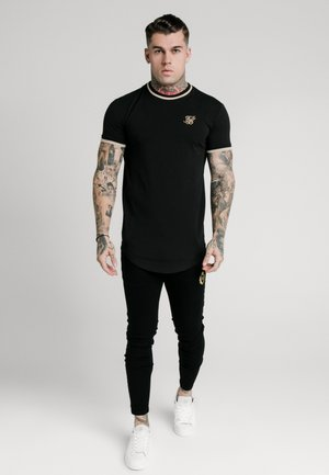 GYM TEE - T-shirt con stampa - black/gold