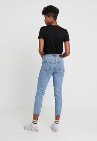 ONLY - ONLEMILY RAW MAE - Straight leg jeans - light blue denim