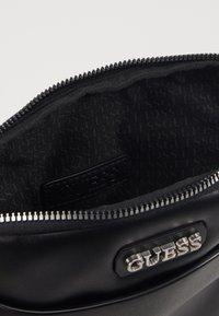 Guess - DAN MINI FLAT CROSSBODY - Across body bag - black - 2