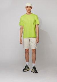 BOSS - TCHUP - Basic T-shirt - yellow - 1