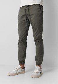 Scalpers - Cargo trousers - khaki - 0