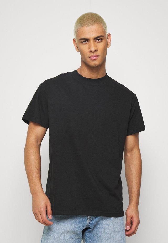 CRUSH - T-shirt con stampa - black