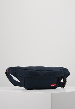 STANDARD BANANA SLING BATWING - Bum bag - navy blue