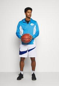 Nike Performance - DRY SHORT PRINT - Sports shorts - white/game royal - 1