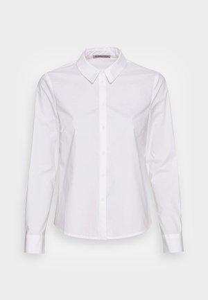 BUSINESS REGULAR - Button-down blouse - white