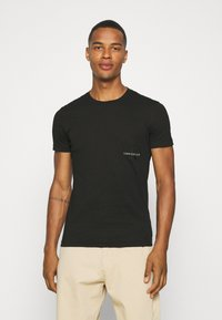 Calvin Klein Jeans - OFF PLACED ICONIC TEE UNISEX - T-shirt con stampa - black - 0