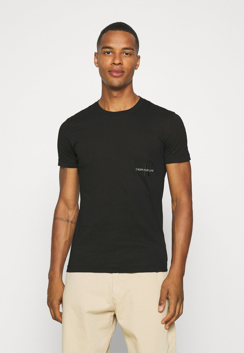 Calvin Klein Jeans - OFF PLACED ICONIC TEE UNISEX - T-shirt con stampa - black