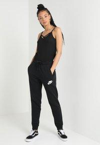 Nike Sportswear - RALLY  - Træningsbukser - black/white - 1