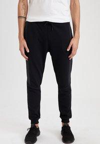 DeFacto - Pantaloni sportivi - black - 0