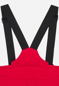 Kjus - BOYS VECTOR PANTS - Zimní kalhoty - scarlet - 4