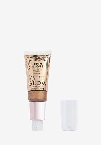 REVOLUTION FACE & BODY GLOSS - Highlighter - bronze