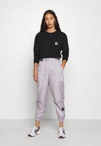 Carhartt WIP - POCKET - T-shirt à manches longues - black - 1