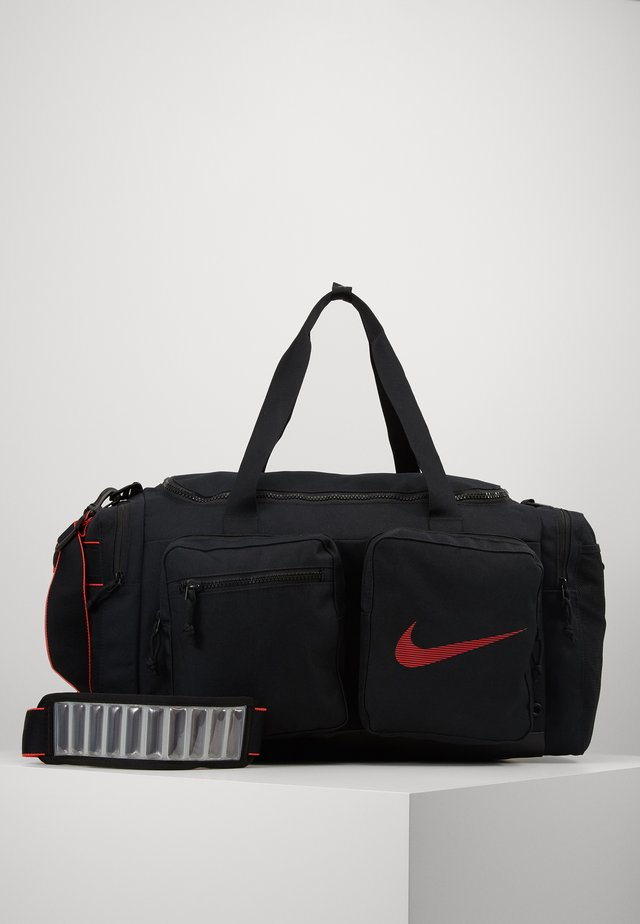 UTILITY M DUFF - Sports bag - black/track red
