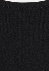 NA-KD - OPEN BACK DETAIL - Långärmad tröja - black - 2