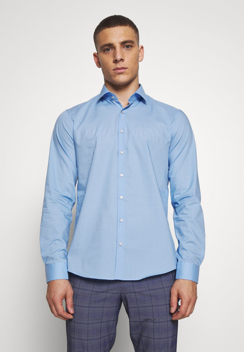 Calvin Klein Tailored - STRETCH - Formal shirt - light blue