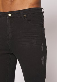 Golden Equation - FADED DISTRESSED MID-RISE - Jeans Skinny Fit - black - 5