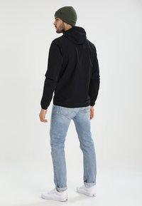 Haglöfs - NATRIX HOOD MEN - Soft shell jacket - true black - 2