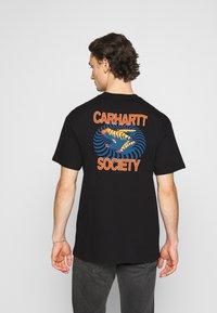Carhartt WIP - SOCIETY - Print T-shirt - black - 2