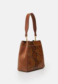 Tory Burch - MCGRAW EXOTIC - Handbag - dark caramel - 1