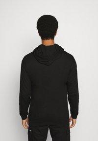 Calvin Klein Jeans - NYCK PHOTOPRINT HOODED - Hoodie - black - 2