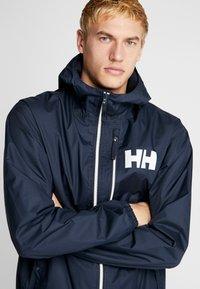 Helly Hansen - BELFAST PACKABLE JACKET - Waterproof jacket - navy - 5