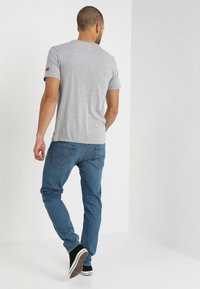 Levi's® - 512 SLIM TAPER  - Slim fit jeans - lightblue denim - 2