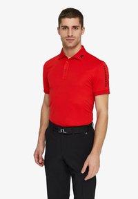 J.LINDEBERG - TOUR TECH SLIM - Sports shirt - racing red - 0