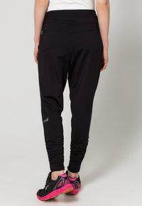 Casall - FLOW - Pantalones deportivos - black - 3