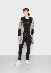 Liu Jo Jeans - MAXI FELPA APERTA - Short coat - nero - 1