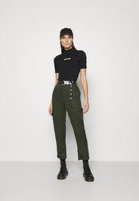 Calvin Klein Jeans - GOLD MICRO LOGO MOCK NECK TEE - Print T-shirt - black - 1