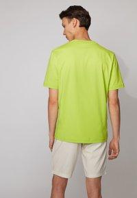 BOSS - TCHUP - Basic T-shirt - yellow - 2
