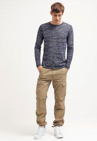 Carhartt WIP - AVIATION PANT COLUMBIA - Cargo trousers - khaki/light brown - 1