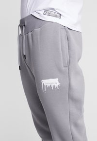STEREOTYPE - Tracksuit bottoms - grey - 3