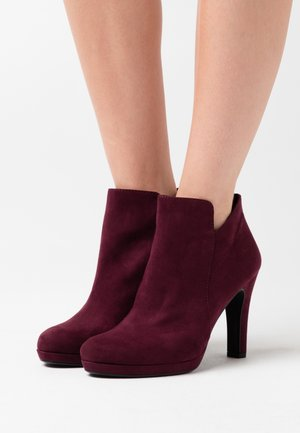 High heeled ankle boots - vine
